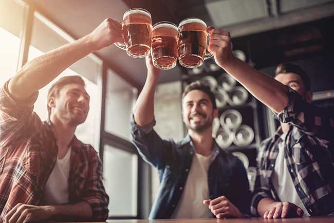 men drinking alcohol which is bad for gut health